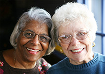 Photo of two women smiling. Link to Life Stage Gift Planner Over Age 70 Situations.