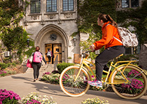 Photo of a student riding a bike. Links to Gifts by Estate Note.