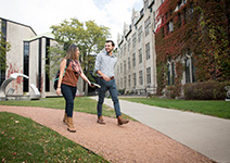 Photo of students walking on campus. Links to Gifts from Retirement Plans.